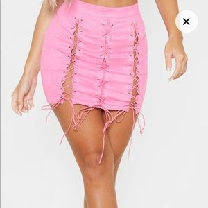 Pretty Little Thing pink lace up skirt